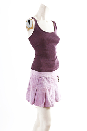 Dark top and purple mini skirt summer spring wear on mannequin full body shop display. Woman fashion styles, clothes on white studio background..