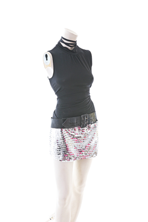 Party top black and silver with mini mirror skirt on mannequin full body shop display. Woman fashion styles, clothes on white studio background..