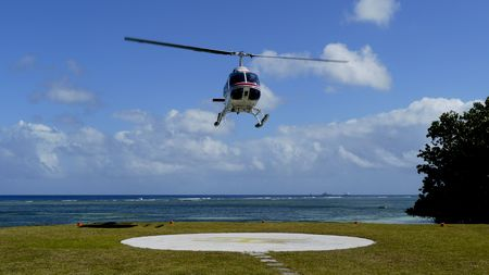 helicopter pilot: Helicopter landing at a tropical beach for scenic flight, La Passe, La Digue Island, Seychelles