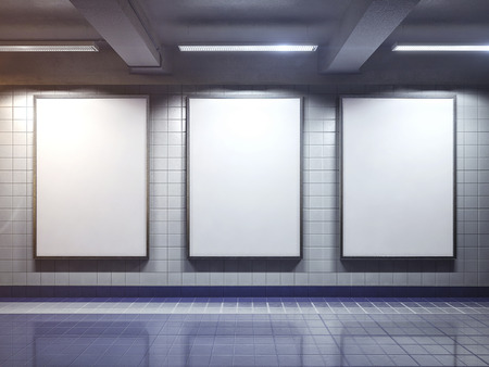 indoors: three big vertical poster on metro station