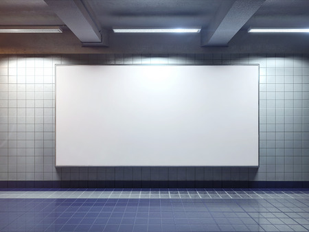white big horizontal poster on metro station