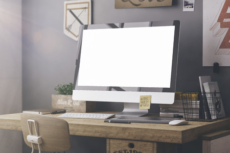 Stylish workspace with computer and posters on home or studio Banque d'images
