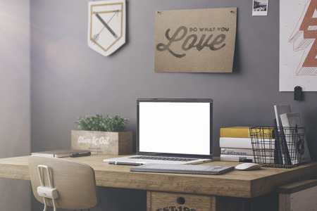 Stylish workspace with computer and posters on home or studio 스톡 콘텐츠