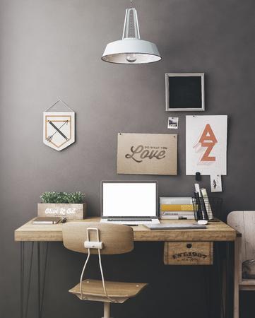 Stijlvolle werkruimte met computer en posters aan huis of atelier