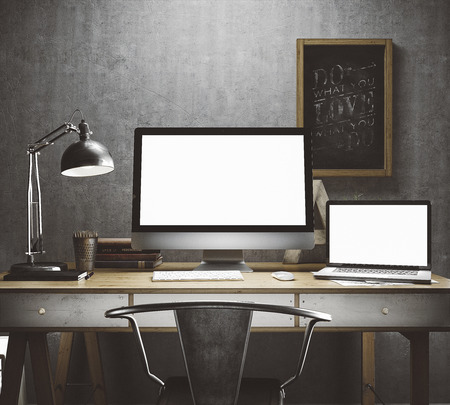 Stylish workspace with computer and posters on home or studio 写真素材