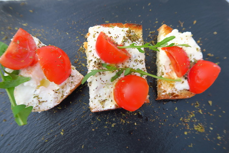 creamed: Sliced bread with creamed cheese & mini tomatoes