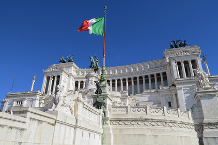 unified: Italian flag at Altare della Patria the Monument to Victor Emmanuel II Rome.  Monumento Nazionale a Vittorio Emanuele II is a monument built in honor of the first king of unified Italy.