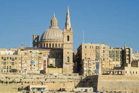 Valletta, Malta.  View of Basilica of Our Lady of Mount Carmel.  One of three cathedrals of the Anglican Diocese of Gibraltar in Europe St Pauls Pro-Cathedral tower is also visible. Editorial