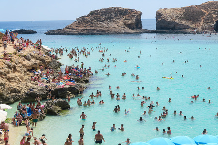 tropica: Comino Island, Malta - 03 August 2016: Tourists at the Blue Lagoon. The most famous and crowded beach in Malta with crystal clear waters. Editorial