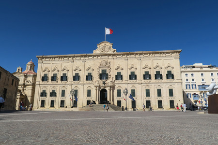 castille: Valletta, Malta - August 02 2016: Facade with Malta flag of Auberge de Castille. This historic two-storey building in Baroque style, is the Office of the Prime Minister of Malta.