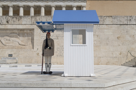 tsolias: Athens, Greece - August 06 2016: A presidential guard at Greek Parliament square. Eyzones are members of the Greek Army with traditional uniforms and guard in pairs the Tomb of The Unknown Soldier.