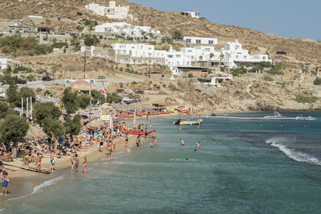 paradise beach: Mykonos, Greece - August 13 2016: Paradise beach filled with tourists. The beach opened to tourists in 1969. Editorial