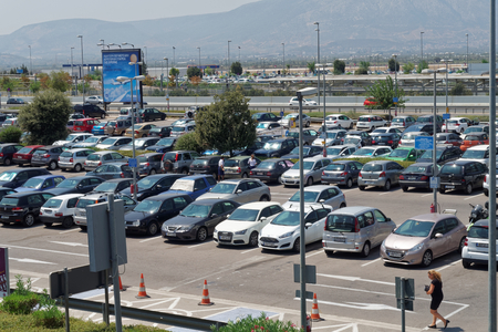 long term: Athens, Greece - August 06 2016: Parked cars at Athens airport parking. At Athens International Airport Eleftherios Venizelos there is available short term and long term parking.
