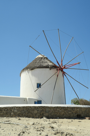 traditional windmill: Mykonos, Greece. Traditional windmill before blue sky. The windmills are the island�s landmark. Stock Photo