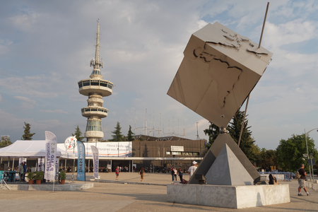 10 12: Thessaloniki, Greece - September 12 2016: Entrance to 81st International fair. 81st Thessaloniki International Fair takes place from 10 to 18 September 2016. OTE telecommunications tower is visible. Editorial