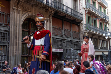 merce: Barcelona, Spain - 24 September 2016 : La Merce annual festival Giants Parade. Each year during the feast oversized figures guided by humans parade spinning around the main streets of Barcelona. Editorial