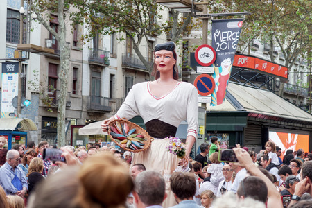 giants: Barcelona, Spain - 24 September 2016 : La Merce annual festival Giants Parade. Each year during the feast oversized figures guided by humans parade spinning around the main streets of Barcelona. Editorial