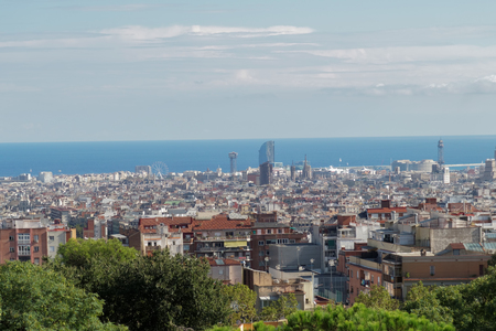 Barcelona, Spain panoramic view from Nature Square at Park Guell Monumental Zone. The public park designed by Antoni Gaudi offers a wide view of Barcelona City.
