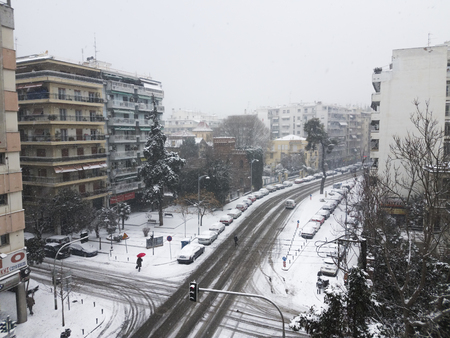 olgas: Thessaloniki, Greece - January 11 2017 second day of heavy snowfall. Traffic conducted with difficulty at main artery Vasilissis Olgas street.
