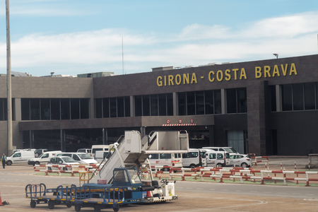 Terminal and sign view from inside airplane of Girona Costa Brava airport. Editorial