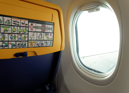 New seat inside a Ryanair Boeing 737 800 aircraft with safety info card.