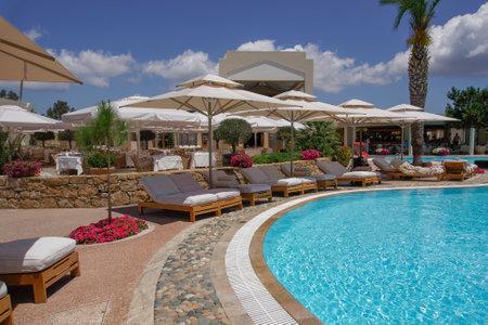 Halkidiki, Greece Sani luxury hotel resort pool view. Day view of outdoor pool at Sani resort in Kassandra Chalkidiki peninsula.