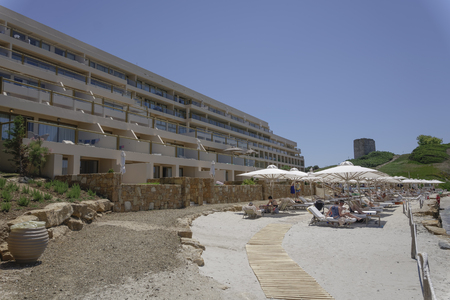 Halkidiki, Greece Sani luxury hotel resort beach view. Day view of hotel complex beach with sunbeds and umbrellas at Sani resort in Kassandra Chalkidiki peninsula. Editorial