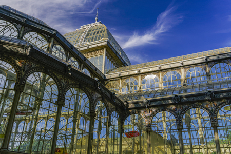 Madrid, Spain Palacio de Cristal iron framework external view detail. Day view of 1887 glass and metal structure of crystal palace at Park Retiro. Editorial