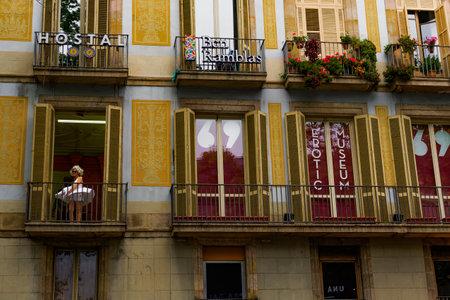 Barcelona, Spain Erotic Museum facade. Woman dressed like Marilyn Monroe on a balcony advertises museum of exhibits on La Rambla. Redakční