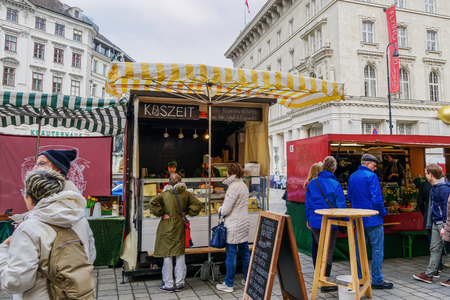 Vienna, Austria Easter open air Food Market Altwiener Freyung Ostermarkt. Crowd at Wien, Osterreich 2019 street market, where local vendors from Austrian regions sell food & drinks. Editorial