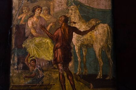 Pompeii, Italy Roman domus house of Vettii fresco painting. North wall triclinium mythological scene depicting Daedalus and Pasiphae. Remains after Mount Vesuvius volcanic eruption in 79 AD.