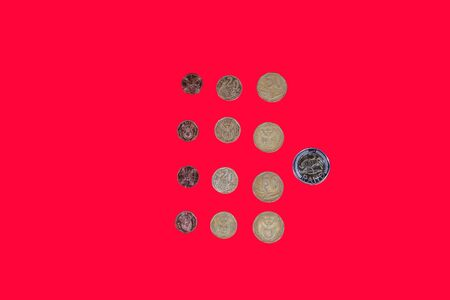 South African rand money coins top view. ZAR official currency of South Africa republic in denominations of bimetallic cent coins on red background. Stock fotó