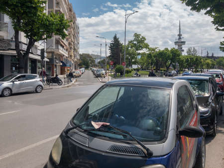 Thessaloniki, Greece Car parking fine penalty charge on windshield. Parked vehicle with ticket fine notice issued by local authorities left on wipers, at a city center road. 報道画像