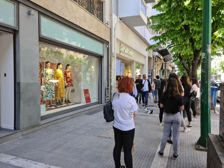 Thessaloniki, Greece Stores open after government loosens COVID-19 measures. Greeks keep their distance outside Stradivarius store as Coronavirus measures affect business & daily life.