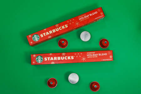 Thessaloniki, Greece - November 8 2020: Starbucks Christmas espresso for automatic Nespresso machine using aluminum capsules. Seasonal limited-edition holiday blend coffee pods to make dripping coffee Editöryel
