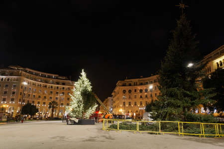Thessaloniki, Greece - December 6 2020: Decorating Christmas tree at Aristotelous square. Night view of festive instalments at the southern part of main city square. Editöryel