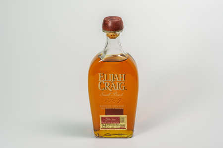 Thessaloniki, Greece - December 14 2020: Elijah Craig alcoholic bourbon drink on display. Small Batch edition of Kentucky Straight Whiskey on 750 ml bottle with logo, against white background.