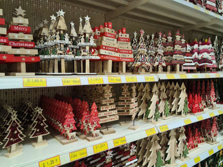 Thessaloniki, Greece - October 27 2020: Christmas wooden Advent Feast products on shelf. Festive decorations figures for sale on display showcase inside shop gallery, with prices in euro. Editöryel