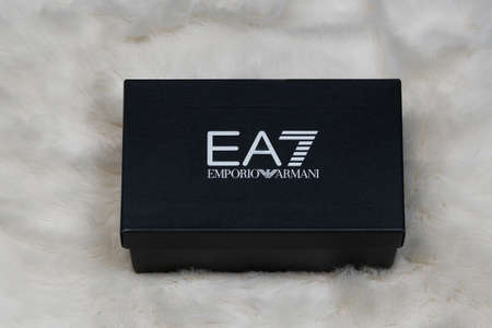 Thessaloniki, Greece - November 23 2020: Emporio Armani online delivery box. Display of order package containing a pair of Italian designers shoes with company logo.