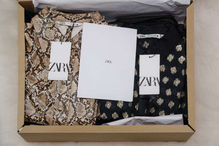 Thessaloniki, Greece - December 5 2020: Zara Spanish clothes brand online delivery box. Open carton order package containing Inditex retailer wearables with company logo.