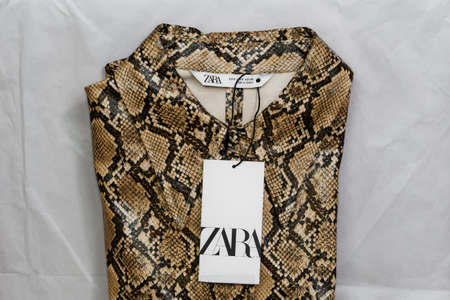 Thessaloniki, Greece - December 5 2020: Zara Spanish clothes brand online delivery. Order package containing Inditex retailer animal print female folded shirt with company logo.