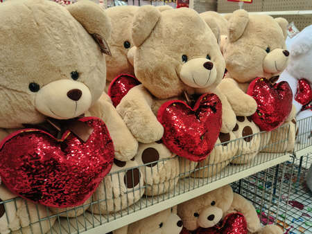 Thessaloniki, Greece - January 21 2021: Happy Valentines day teddy bears shop showcase. Interior view of romantic love stuffed toys with hearts sold as gifts for the annual February 14 feast. Editöryel