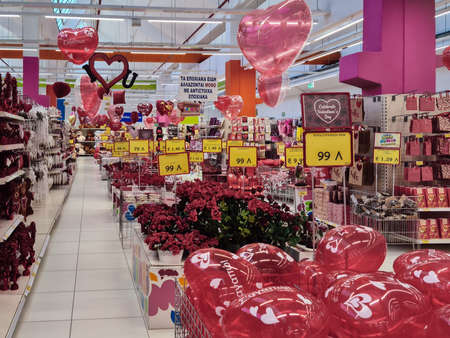 Thessaloniki, Greece - February 3 2021: Happy Valentines day inflatable hearts and flowers shop showcase. Interior view of romantic love decor items sold as gifts for annual February 14 feast. Editöryel