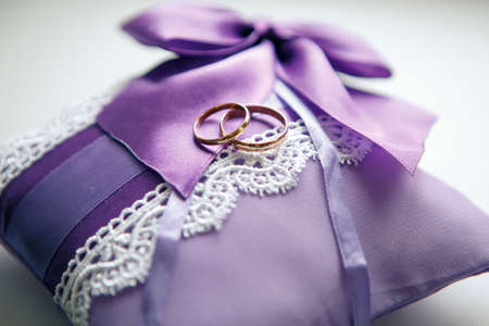 affiance: Weddings ring on the serenity pillow on a white background Stock Photo