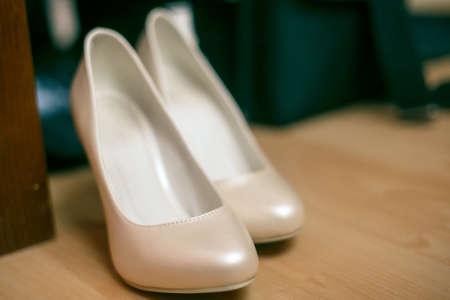 Wedding Shoes Cream Coloured White On The Floor Photo