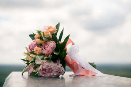 pion: Wedding bouquet from pink pions and roses