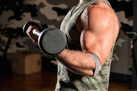 Close-up frame of barbell and pumped up male hands Imagens