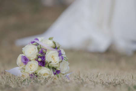 Bridal bouquet with bride in the background photo