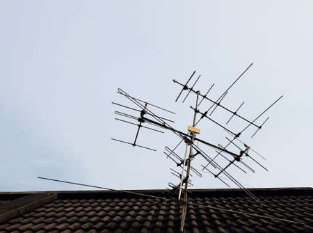 signal device: Antenna on the roof above the blue sky
