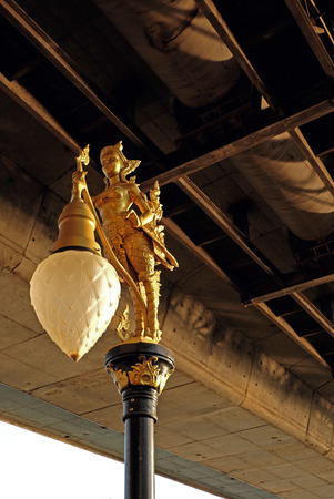 statuary: Lighting golden sculpture column under the bridge